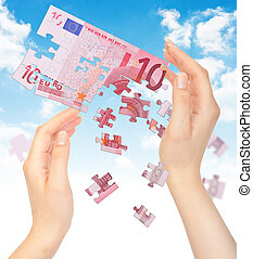 Hands and puzzle out of the money EURO