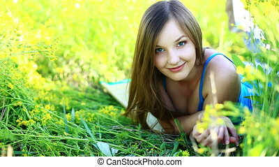 Beautiful girl lying in the grass.