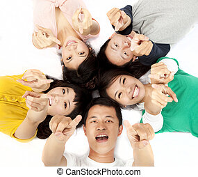 happy asian young group pointing at you