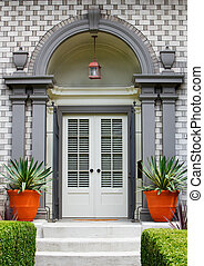 Elegant Home Front Door with gray wood arch and alternating...