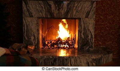 Man by fireplace - Man relaxing in rocking chair in front of...