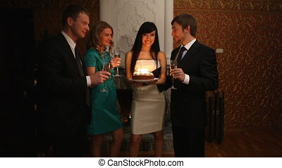 Party cake - Elegant girl holding cake with candles and...