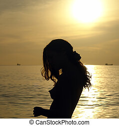Young woman on the beach - Silhouette of young woman