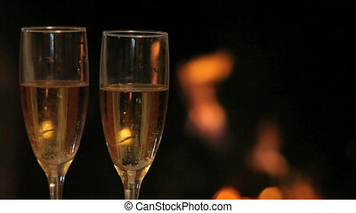 Champagne flutes - Two flutes with champagne on the...