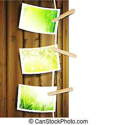 green foliage photos pinned to a rope - Hanging green...