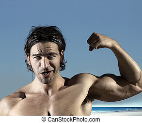 Sexy bicep guy - Portrait of a muscular fun guy flexing his...