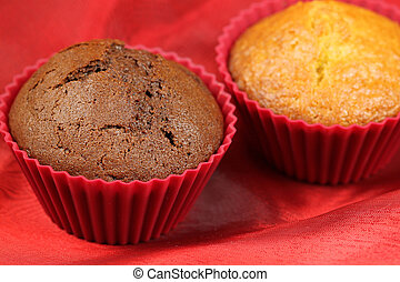 dark and bright cupcakes - Bright and dark muffins in red...