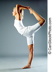 Yoga - Image of female doing physical exercise for...