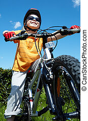 Lad on bicycle - Portrait of happy child on bicycle against...