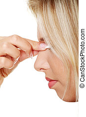 Sinus pain - Young woman with sinus pressure pain , isolated...