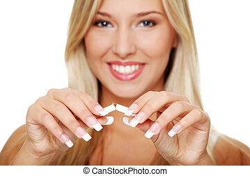 Young woman quitting smoking - Young beautiful blond smiling...