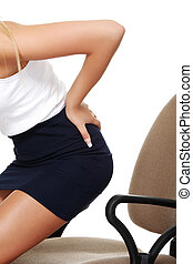 Business woman with back pain after long work on chair...