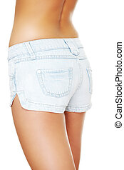 Young sexy woman wearing jean shorts isolated on white