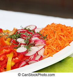garnished, fresh salad with radishes, carrots and peppers