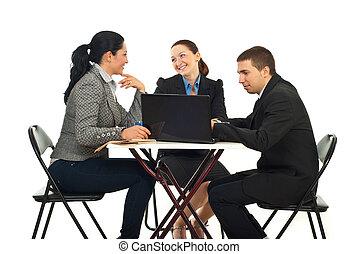 Business team having a break - Business team having...