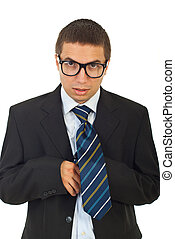 Funny businessman with eyeglasses fastening tie and looking...