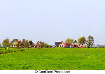 Farmhouses in Holland - Row modern farmhouses in agriculture...