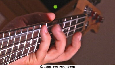 playing at electric guitar - close-up man hands playing at...