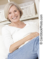 Portrait of Attractive Senior Woman Relaxing At Home