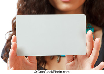 Beautiful young businesswoman holding businesscard studio...
