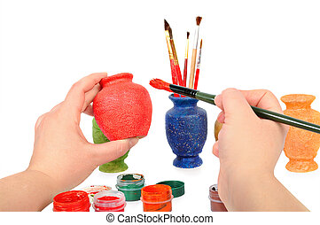 Female hands a brush paint a vase Craft concept Isolated on...