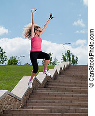 Woman in sportswear jumping