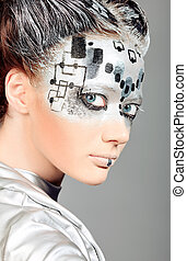 face art - Portrait of a futuristic young woman.