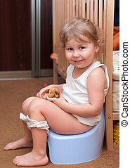 Little girl sitting on a potty - Little girl sitting on a...