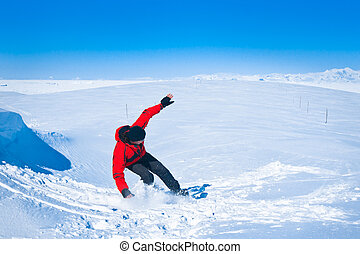 Man moves on snowboard Glacier in background Antarctica