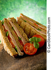 Delicious Sandwich on wooden table - photo of delicious...