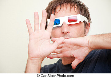Man with 3D glasses - Man with anaglyph 3D glasses making...