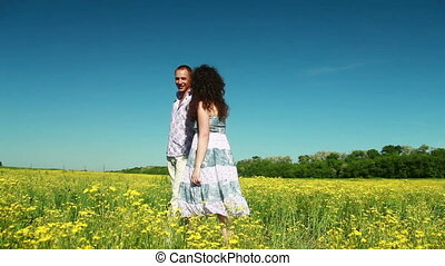 Loving couple walking in field