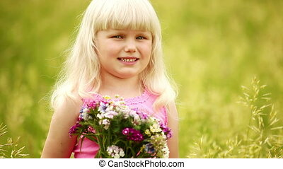 Little blonde with flowers.