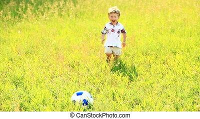 Little football player scores a goa - Children outdoors