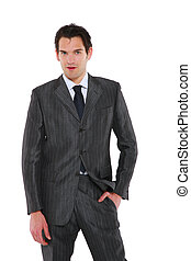 businessman standing with hand in pocket
