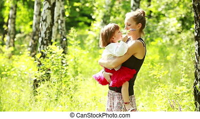 Hugging mother and girl