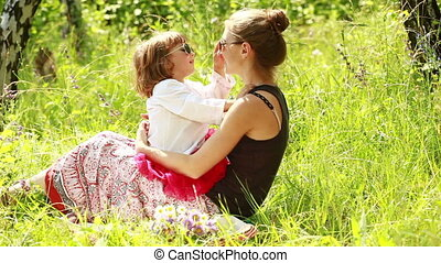 Mother and baby in sunglasses.