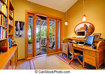 Yellow home office with an open door to the deck