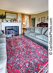 Beautiful antique red rug in the living roon