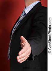business man open hand ready to seal a deal red background