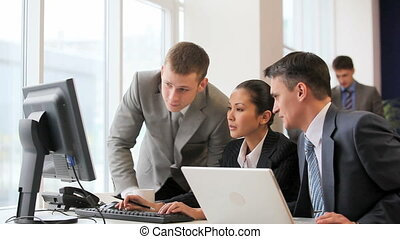 Discussion of presentation - Businesspeople looking at...