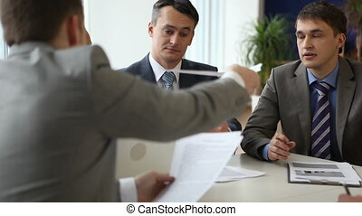 Business plan - Businesspeople sitting at the boardroom and...