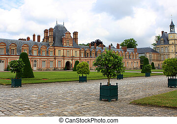 Fontainebleau palace with garden outside of Paris, France
