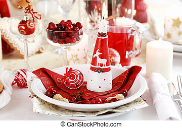 Table setting for Christmas with apple pie and cranberry...
