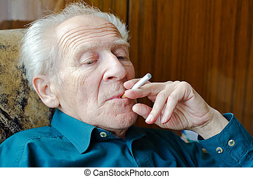 Smoking Electronic Cigarette - thoughtful senior man smoking...