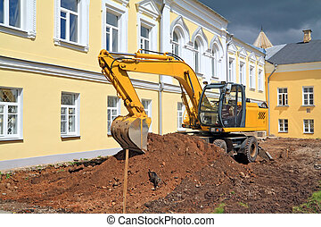 excavator near townhouse