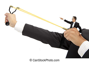 business motivate concept. businessman with slingshot and...