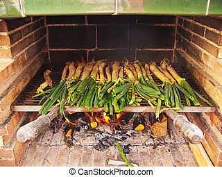 Calçots, catalan sweet and young onions being roasted in the...