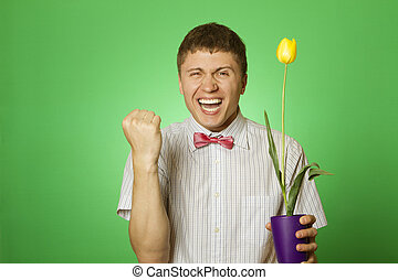 Man holding a yellow tulip