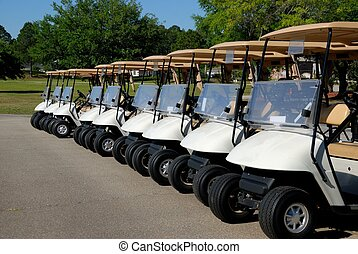 Golf Carts All In A Row - golf carts at course in St....